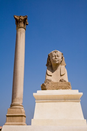 Pompeys Pillar and a sphinx in Alexandria, Egypt Stock Photo