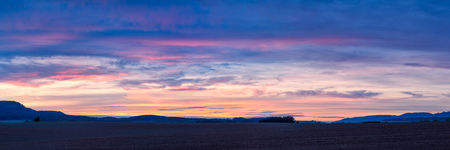 Colorful sunset over plowed fields in Northern Bohemia in the Czech Republic, Europe