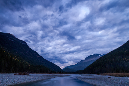 Mountain River in the Canadian Rocky Mountains, British Columbia, Canada in later afternoon light.