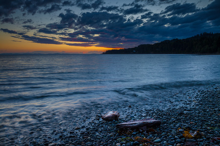 Pebbly beach on Vancouver Island, British Columbia, Canada at sunset