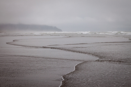 A cold and rainy day on the beach in Washington, USA