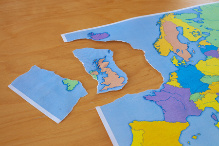 a torn paper map symbolizing the UK leaving the European Union or Brexit Stock Photo