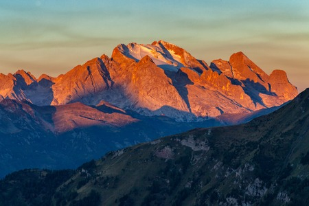 Colorful sunrise over Marmolada, the highest mountain in the Dolomites, Italy