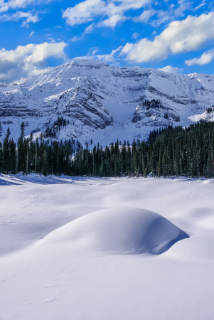 A snow covered mountain on a clear blue winter day in the Canadian Rocky Mountains at Black Prince Cirque in Peter Lougheed Provincial Park, Alberta, Canada