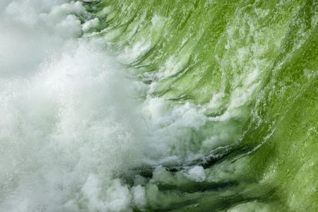 The Spokane river in spring flood near downtown Spokane, Washington, USA