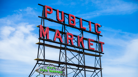 SEATTLE, WASHINGTON, USA - JULY 4, 2014: The iconic sign at the Seattle Public Market a nice blue sky