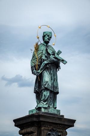 PRAGUE, CZECH REPUBLIC - MAY 21, 2009: Statue on the historic Charles Bridge in Prague, Czech Republic Redakční