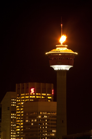 CALGARY, ALBERTA, CANADA -JANUARY 18, 2010: The Calgary Tower in Downtown Calgary, Alberta with its iconic flame lit
