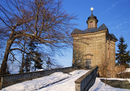 BROUMOV, CZECH REPUBLIC - MARCH 9, 2010: The Star Chapel in the hills above the town of Broumov in north-eastern Czech Republic, Europe