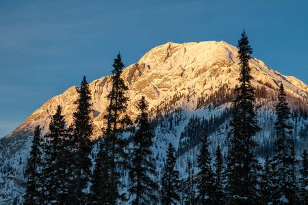 Sunset in the mountains of Spray Valley Provincial park in Kananaskis, Alberta, Canada