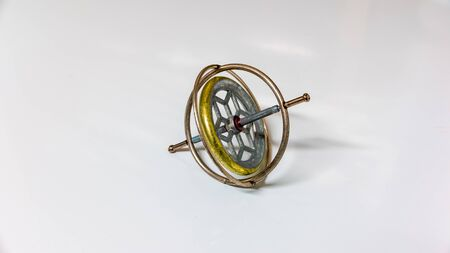 A metal toy gyroscope isolated on a white background