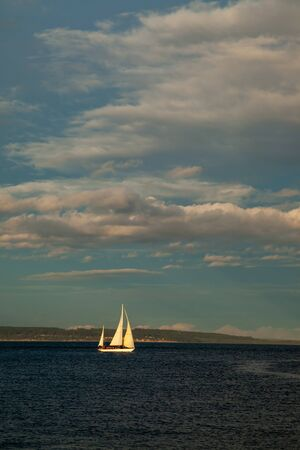 A small Sailboat on the water at sunset near Port Townsend, Washington, USA Banco de Imagens