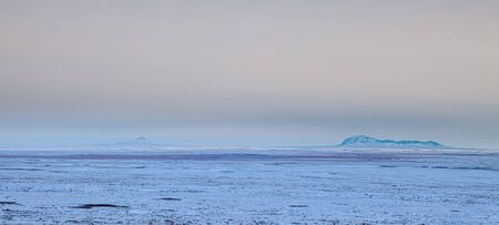 Distant view of the Sweet Grass Hills in northern Montana, USA, on a cold winters evening Banco de Imagens