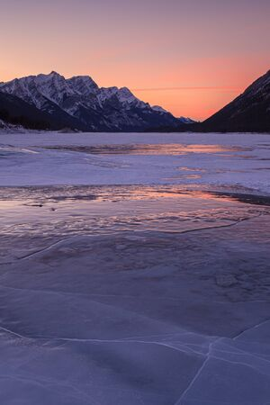 Sunset on a frozen lake in Kananaskis Country in the Canadian Rocky Mountains, Albeta, Canada