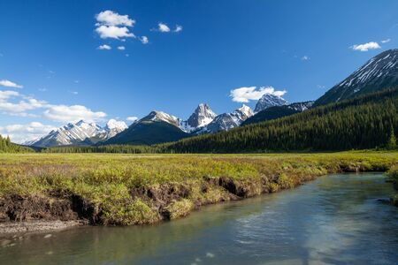 A creek and mountains in Kanaknskis Alberta, Canada Stock Photo