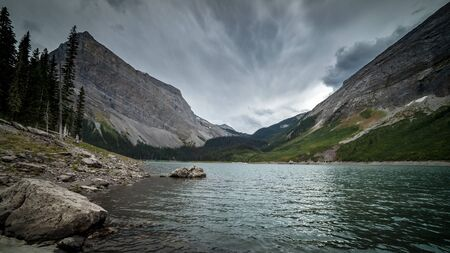 A mountain lake in the Canadian Rockies on a cold stormy day, Alberta, Canada Stock Photo