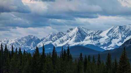 A moody sky over a mountain range in Kananaskis Country, Alberta, Canada