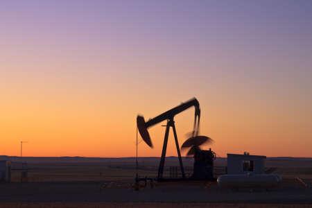 Oil pump jack at sunrise in Alberta, Canada