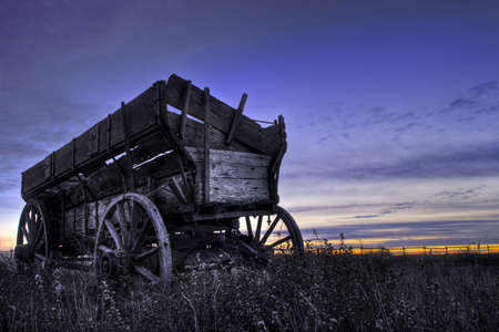 Old wooden wagon in a field near Drumheller, Alberta, Canada