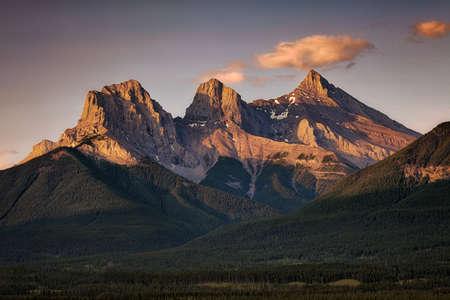 Three Sisters at Sunrise near Canmore, Alberta, Canada Banco de Imagens