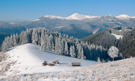 Winter landscape with a mountain valley. photo