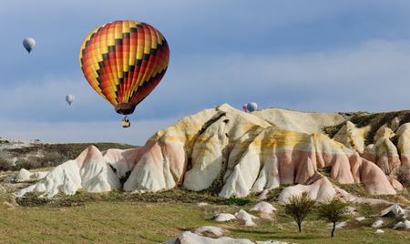 crannied: Balloon on a background of colored mountains