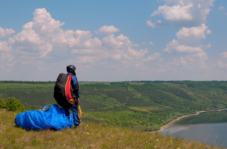 paraglider: Paraglider prepares to fly over beautiful Bakota reservoir. Ukraine