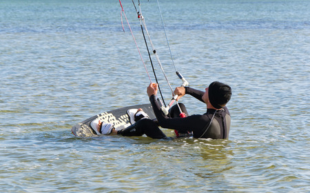 kiter: Kite Surfer gets up on the board on the Black Sea Stock Photo