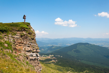 holidaymaker: A man with a large backpack is looking into the distance over obryvomi