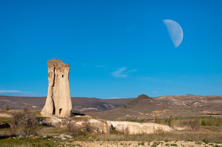 pidgeon: Ancient cave city in the limestone rock and the moon, Cappadocia, Turkey Stock Photo
