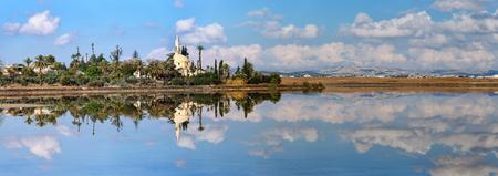 umm: Hala Sultan Tekke or Mosque of Umm Haram is a Muslim shrine on the west bank of Larnaca Salt Lake in Cyprus. Stock Photo