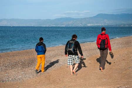 pebble beach: People walk on the pebble beach on the Mediterranean Sea, Cyprus
