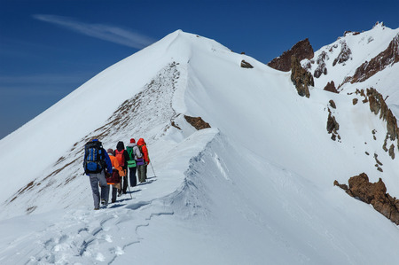 crampons: Group of climbers goes down from the top of Erciyes volcano. Turkey Stock Photo