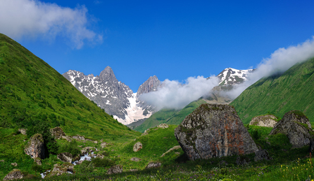 caucas: Summer landscape with river, big stones and mountain snow. Georgia. Stock Photo