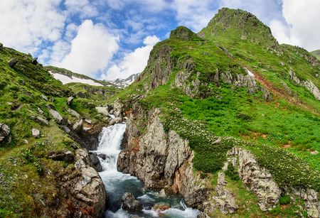 Summer mountain landscape with river and waterfall. Georgia. Stock Photo