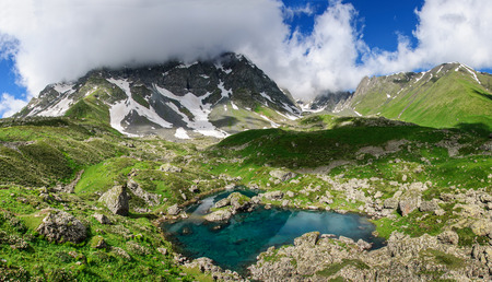 abkhazia: Picturesque lake in valley of Caucasus mountains in Georgia Stock Photo