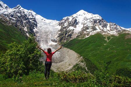 svaneti: Young hikers trekking in Svaneti, Georgia. Glacier ladaar in the background