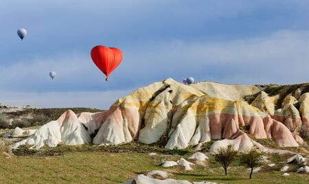 gully: Balloon on a background of colored mountains