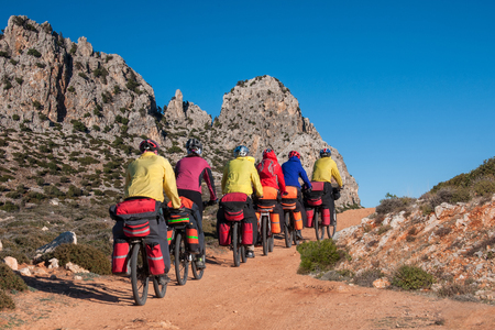 group of biker tourists with large backpacks travel through the mountains in Turkey Stock Photo