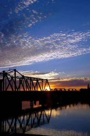 trestle: Trestle Bridge at Sunset over San Juaquin River, Central Valley, California Stock Photo