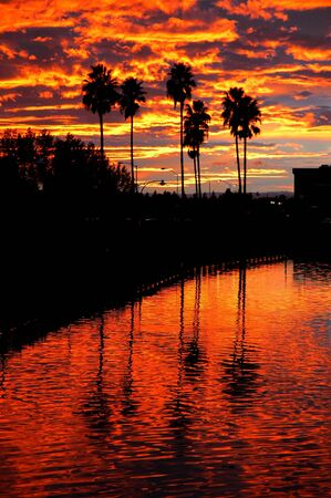 Webber Point Silhoutted Red Sunset Reflection, Stockton Callifornia Stock Photo