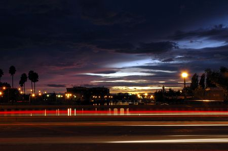streaks: Light Streaks of Moving Traffic Against Late Sunset, Weber Point, Stockton, California, USA Stock Photo