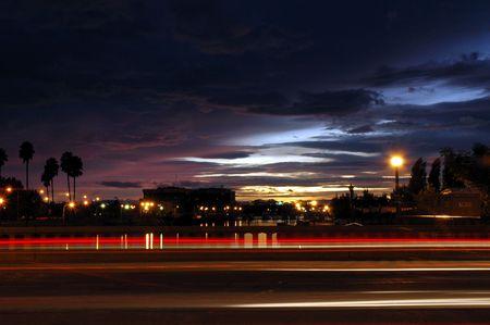 Light Streaks of Moving Traffic Against Late Sunset, Weber Point, Stockton, California, USA Banco de Imagens