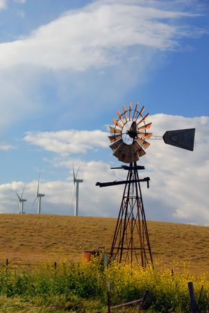 Old Ranch Windmill Contrasted Against New Electrical Power Generating Windmills, Digital Velvia, Rio Vista, California photo