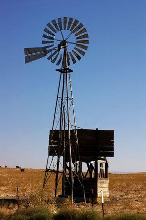 water mill: Western Water Pumping Livestock Ranch Windmill On California Rangeland