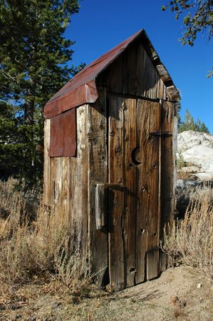 privy: Abandoned Wooden Privy with Classic Crescent Moon Cut In Door and Rusty Tin Roof, Back Country Wilderness, Sierra Nevada Range
