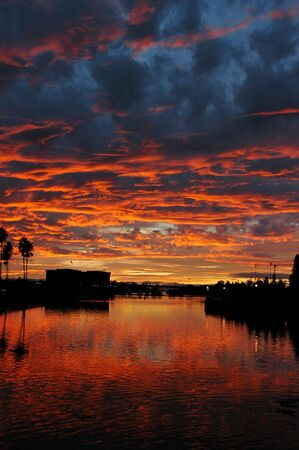 Weber Point Silhouetted Red Sunset Reflection, Palm Trees, Stockton, California