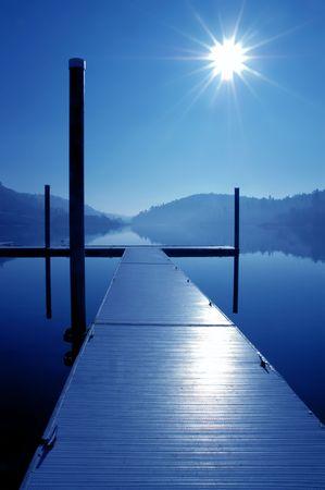 Dock, Blazing Sun, and Mirror Lake Reflection, in Blue Mood Banco de Imagens