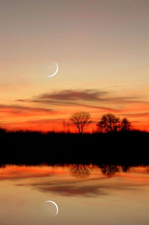 New Moon, Sunset, and Riparian Tree Reflection over Still Riparian Slough in Wildlife Preserve, Sacramento Delta, Central Valley, California