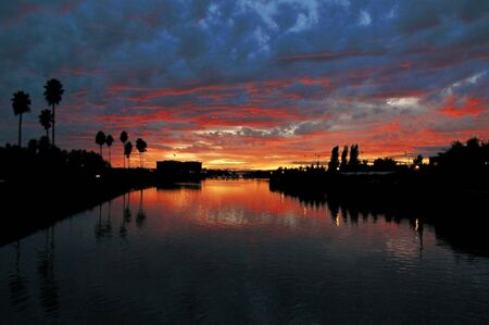 Weber Point Silhoutted Red Sunset Reflection, Stockton Callifornia